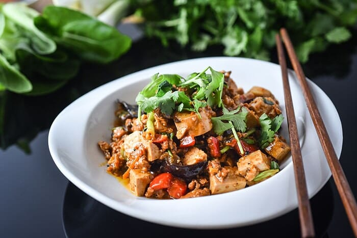 Tofu stir-fried with mushrooms and tomatoes
